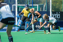 Reading's Leah Wilkinson is tackled by Els Mansell of Clifton. Investec Women's Hockey League Finals Weekend, Sonning Lane, Reading, UK on 13 April 2014. Photo: Simon Parker
