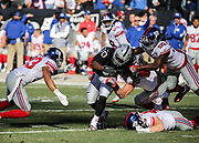 Dec 3, 2017; Oakland, CA, USA; Oakland Raiders running back Jalen Richard (30) has the ball striped during a punt return by New York Giants linebacker Ray-Ray Armstrong however the Raiders recover the ball during an NFL game at Oakland-Alameda County Coliseum.