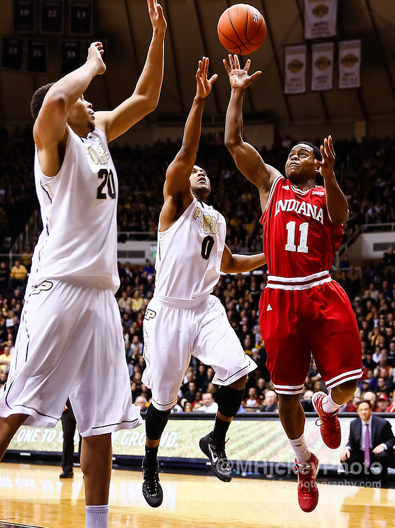 WEST LAFAYETTE, IN - JANUARY 30: Kevin Ferrell #11 of the Indiana Hoosiers shoots the ball against A.J. Hammons #20 of the Purdue Boilermakers and Terone Johnson #0 of the Purdue Boilermakers at Mackey Arena on January 30, 2013 in West Lafayette, Indiana. Indiana defeated Purdue 97-60. (Photo by Michael Hickey/Getty Images) *** Local Caption *** Kevin Ferrell; A.J. Hammons; Terone Johnson