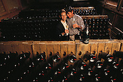 Sparkling wine cellar of Ironhorse Winery, Sebastapol, California.  CEO Joy Sterling and winemaker Forrest Taucer in the sparkling wine cellar. MODEL RELEASED.