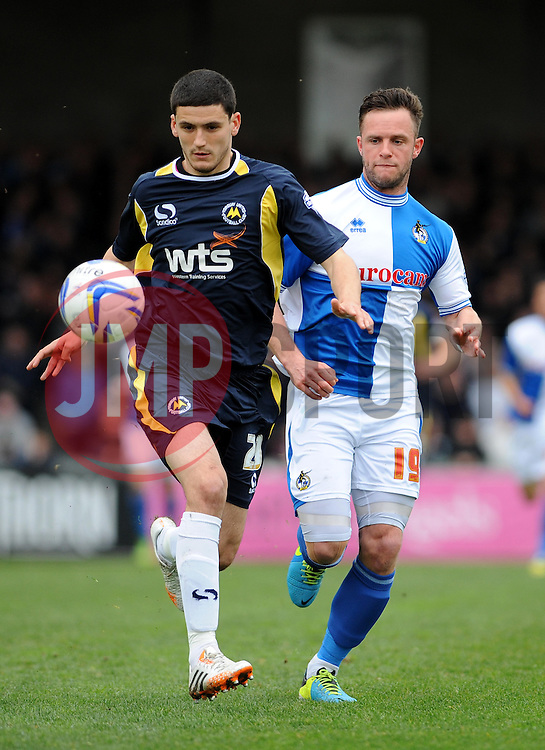 Bristol Rovers' Chris Beardsley chases down Torquay United's Anthony O'Connor  - Photo mandatory by-line: Dougie Allward/JMP - Mobile: 07966 386802 12/04/2014 - SPORT - FOOTBALL - Bristol - Memorial Stadium - Bristol Rovers v Torquay United - Sky Bet League Two