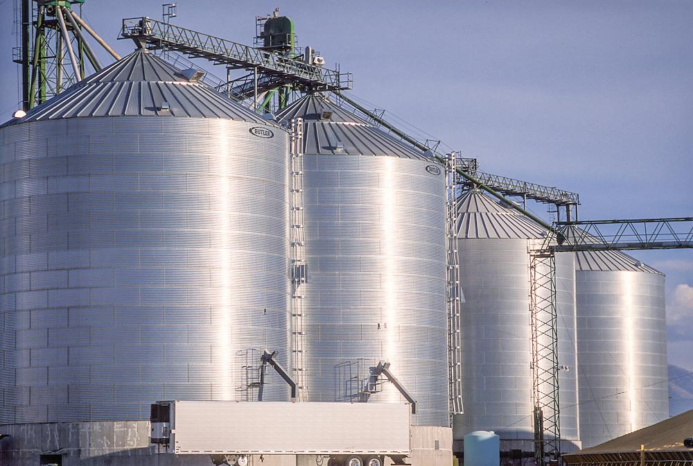 Idaho, USA - Grain elevator, grain, and rail cars<br /> Peavey