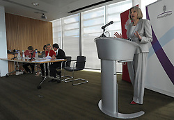 © licensed to London News Pictures. LONDON. UK  14/09/11. Theresa May delivers her keynote speech. Home Secretary and Minister for Women and Equalities, Theresa May, launches 'Voluntary Gender Equality Analysis and Reporting' guidance for employers at Eversheds law firm in Central London today (14 Sept 2011). Photo credit should read Stephen SImpson/LNP