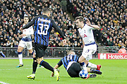 Inter Milan defender Stefan de Vrij (6) tackles Tottenham Hotspur midfielder Harry Winks (8) during the Champions League group stage match between Tottenham Hotspur and Inter Milan at Wembley Stadium, London, England on 28 November 2018.