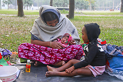 November 19, 2018 - Dhaka, Bangladesh - A homeless mother is getting prepared to spent a long cold night under the open sky in a park with her 2 daughters one is 10 days old and the other is 4 years old on November 19,  2018 in Dhaka, Bangladesh. (Credit Image: © Khandaker Azizur Rahman Sumon/NurPhoto via ZUMA Press)