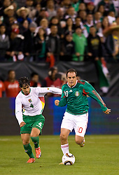 February 24, 2010; San Francisco, CA, USA;  Mexico forward Cuauhtemoc Blanco (10) breaks away from Bolivia defender Marvin Bejarano (4) during the first half at Candlestick Park.  Mexico defeate Bolivia 5-0.