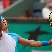 08 June 2007: Spanish player Rafael Nadal serves to Serbian player Novak Djokovic during the French Tennis Open semi final won 7-5, 6-4, 6-2, by Rafael Nadal over Novak Djokovic on day 13 at Roland Garros, in Paris, France.