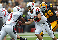 September 25 2010: Ball State Cardinals quarterback Keith Wenning (10) hands the ball off to Ball State Cardinals tailback Eric Williams (3) during the first half of the NCAA football game between the Ball State Cardinals and the Iowa Hawkeyes at Kinnick Stadium in Iowa City, Iowa on Saturday September 25, 2010. Iowa defeated Ball State 45-0.