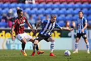 Wigan Athletic midfielder James McClean and Beram Kayal, Brighton midfielder during the Sky Bet Championship match between Wigan Athletic and Brighton and Hove Albion at the DW Stadium, Wigan, England on 18 April 2015.