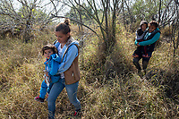 Central American immigrants who entered the U.S. illegally get detained by the border patrol in a remote area of South Texas, along the U.S.-Mexico border, on February 2, 2017 (Photo/Scott Dalton)