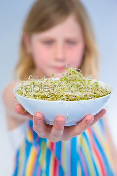Girl Holding Bowl of Alfalfa Sprouts