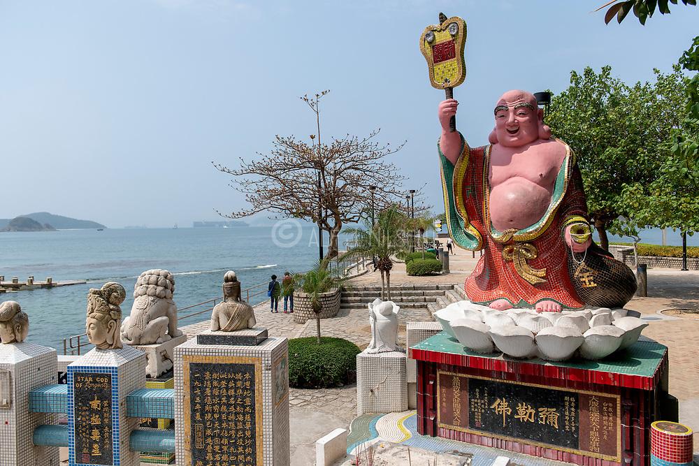 Money God at Repulse Bay pier, Hong Kong Island, China.