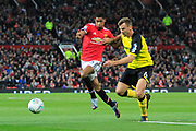 Burton Albion defender Ben Turner (6) battles for the ball with Manchester United striker Marcus Rashford (19) during the EFL Cup match between Manchester United and Burton Albion at Old Trafford, Manchester, England on 19 September 2017. Photo by Richard Holmes.
