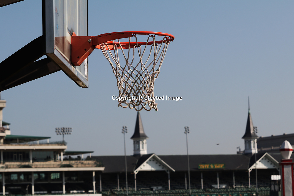 Sports collide with a view from the backside community's basketball court looking at Churchill Downs' front side in Louisville, Kentucky