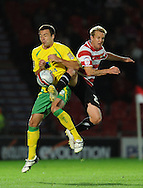 Doncaster - Tuesday September 14th, 2010:  Norwich City's Russell Martin and Doncaster Rovers's James Coppinger in action during the NPower Championship match at Keepmoat Stadium, Doncaster. (Pic by Dave Howarth/Focus Images)