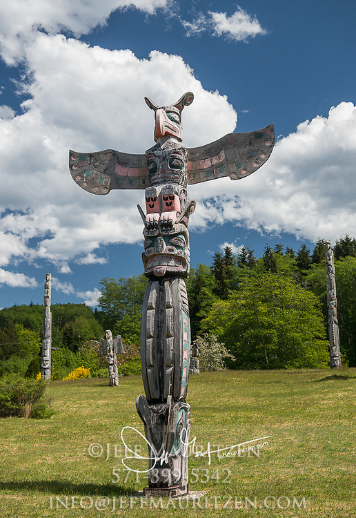 otem Poles In The Namgis Burial Grounds; Alert Bay, Cormorant Island, British Columbia, Canada