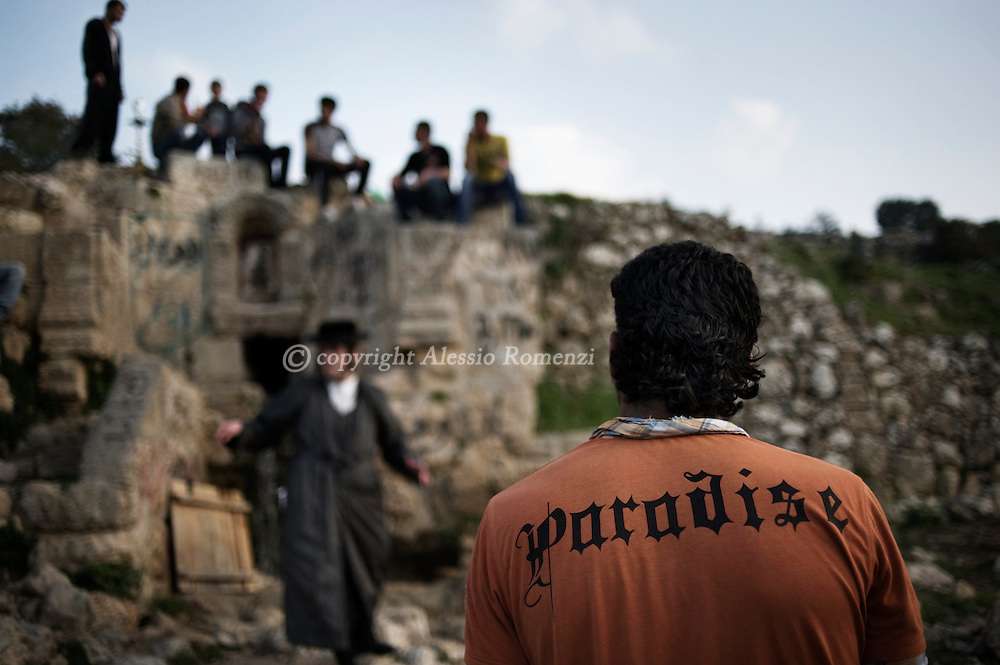 .JERUSALEM - outskirts of Jerusalem on March 28, 2010 during the maim shelanu (rested water) ceremony in preparation for the Pesah (Passover) holiday. The water is used in baking the unleavened bread, known in Hebrew as Matzoh, which religious Jews throughout the world eat during the eight-day holiday. This year, Passover --commemorating the Israelites' exodus from Egypt some 3,500 years ago -- will begin at sunset on March 29.© ALESSIO ROMENZI
