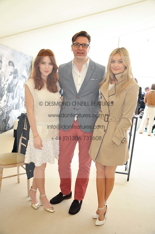 Left to right, ANGELA SCANLON, PAUL JAMES Global Brand Leader for St. Regis Hotels & Resorts and LAURA WHITMORE at the St.Regis International Polo Cup between England and South America held at Cowdray Park, West Sussex on 18th May 2013.  South America won by 11 goals to 9 goals.