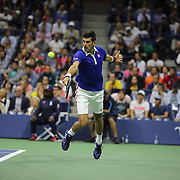 Novak Djokovic, Serbia, in action against Roger Federer, Switzerland, in the Men's Singles Final during the US Open Tennis Tournament, Flushing, New York, USA. 13th September 2015. Photo Tim Clayton
