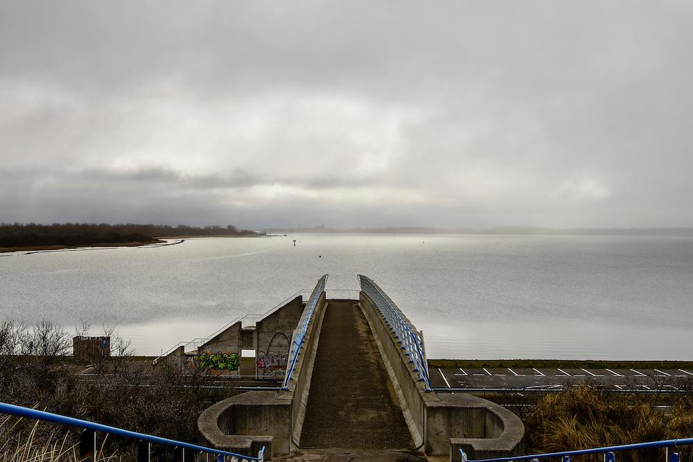 Nederland, Zeeland, Gemeente Schouwen-Duiveland, 18-03-2016; Veerse Meer met Veere aan de horizon, gezien vanaf de Veerse Gatdam, met loopbrug  naar parkeerterrein. <br /> <br /> <br /> copyright foto/photo Siebe Swart