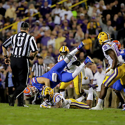 Oct 12, 2019; Baton Rouge, LA, USA; Florida Gators quarterback Kyle Trask (11) is flipped over on a tackle by LSU Tigers safety Grant Delpit (7) during the first half at Tiger Stadium. Mandatory Credit: Derick E. Hingle-USA TODAY Sports