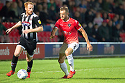Grimsby Town defender Liam Gibson challenged by Salford City defender Scott Wiseman during the EFL Sky Bet League 2 match between Salford City and Grimsby Town FC at Moor Lane, Salford, United Kingdom on 17 September 2019.