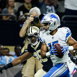Oct 15, 2017; New Orleans, LA, USA; Detroit Lions wide receiver Golden Tate (15) runs after a catch past New Orleans Saints defensive back Rafael Bush (25) for a touchdown during the first quarter of a game at the Mercedes-Benz Superdome. Mandatory Credit: Derick E. Hingle-USA TODAY Sports