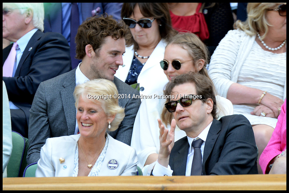 Image ©Licensed to i-Images Picture Agency. 03/07/2014. London, United Kingdom. Laura Haddock and Colin Firth in the Royal Box at the  Wimbledon Tennis Championship for Day Ten.  Picture by Andrew Parsons / i-Images