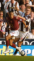 Photo: Leigh Quinnell.<br /> West Bromwich Albion v Arsenal. The Barclays Premiership.<br /> 15/10/2005. West Broms Martin Albrechtsen battles with Arsenals Gael Clichy.