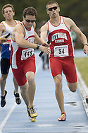 Young, Sean taking the stick from Cummings, Brian competing in the 4x400m relay at the 2007 OTFA Junior-Senior Championships in Ottawa.