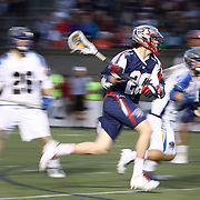 Owen Blye #20 of the Boston Cannons runs with the ball during the game at Harvard Stadium on May 17, 2014 in Boston, Massachuttes. (Photo by Elan Kawesch)
