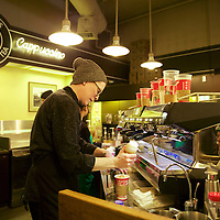Non-stop baristas at the original Starbucks store at 1912 Pike Place, Seattle. A mecca for Starbucks drinkers & tourists.