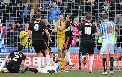 Fulham's Marcus Bettinelli is congratulated by his team-mates after saving a penalty - Photo mandatory by-line: Richard Martin-Roberts/JMP - Mobile: 07966 386802 - 21/03/2015 - SPORT - Football - Huddersfield - John Smith's Stadium - Huddersfield Town v Fulham - Sky Bet Championship