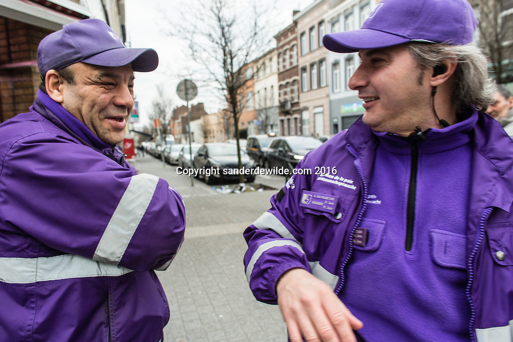 20160319 story on the streets and people of Molenbeek, after Salam Abdeslam was arrested a day before. Two peacekeepers (police without arms) making fun and happy that things change now in Molenbeek