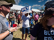 13 AUGUST 2019 - DES MOINES, IOWA: Supporters of Pete Buttigieg wait for him to take the stage at the Des Moines Register Political Soapbox. Buttigieg, the Mayor of South Bend, Indiana, is running to be the Democratic nominee for the US presidency. He spoke at the Des Moines Register Political Soap Box at the Iowa State Fair and then toured the fairgrounds. Iowa has the first event of the presidential selection cycle. The Iowa Caucuses are February 3, 2020.               PHOTO BY JACK KURTZ