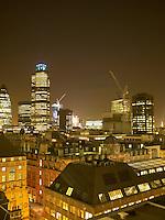 Illuminated cityscape with cranes at night