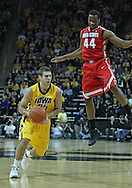 January 07, 2011: Iowa Hawkeyes guard/forward Eric May (25) drives past Ohio State Buckeyes guard William Buford (44) during the the NCAA basketball game between the Ohio State Buckeyes and the Iowa Hawkeyes at Carver-Hawkeye Arena in Iowa City, Iowa on Saturday, January 7, 2012.