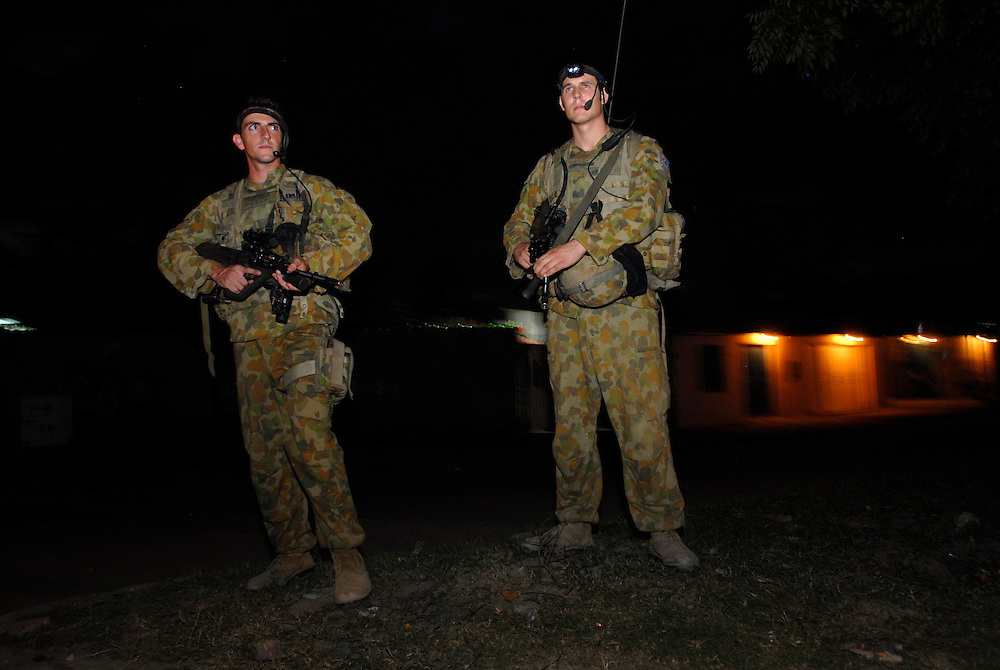 Australian soldiers patrol Dili streets at night.