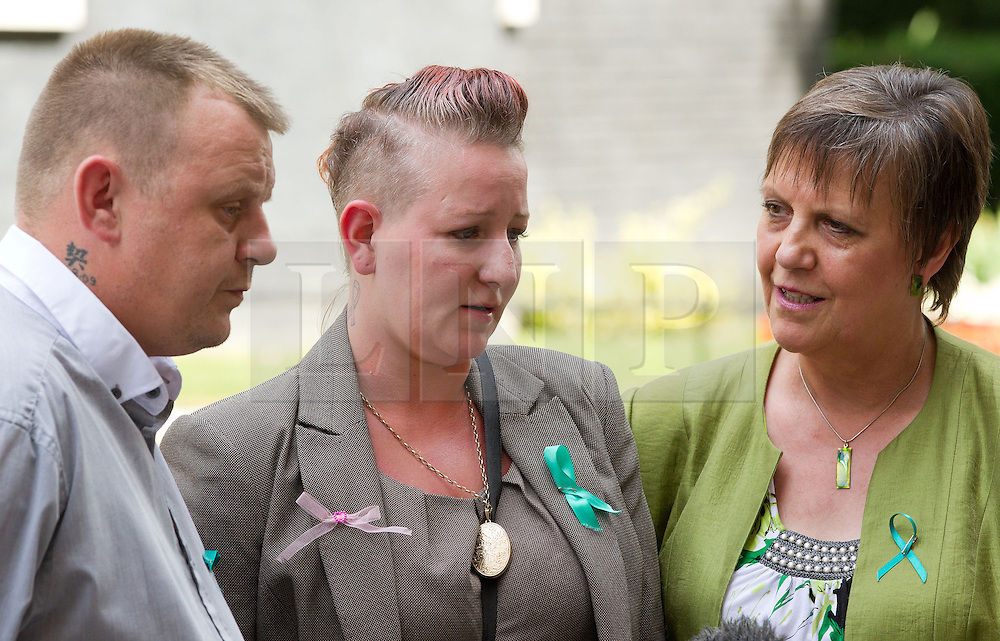 © Licensed to London News Pictures. 16/07/2013. London, UK. Julie Hilling, MP for Bolton West (R) and Shirley (C) and Michael Anderson (L), the parents of Jade Anderson, who was mauled to death by dogs, stand in Downing Street after handing in a petition to Number 10 Downing Street today (16/07/2013) calling on the Government to take more action on dangerous dogs. Photo credit: Matt Cetti-Roberts/LNP