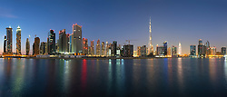 Evening skyline of modern buildings and Burj Khalifa at Business Bay in United Arab Emirates