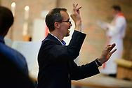 Charles Brown, associate professor of music at CUC, conducts the choir at the opening Divine Service in the Chapel of Our Lord during the 2017 Institute on Liturgy, Preaching and Church Music on Tuesday, July 25, 2017, on the campus of Concordia University Chicago in River Forest, Ill. LCMS Communications/Erik M. Lunsford