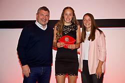 NEWPORT, WALES - Saturday, May 19, 2018: Grace Morris is presented with her Under-16's cap by Osian Roberts (left) and Lauren Dykes (right) during the Football Association of Wales Under-16's Caps Presentation at the Celtic Manor Resort. (Pic by David Rawcliffe/Propaganda)