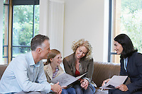 Parents and daughter (7-9) with estate agent discussing new property