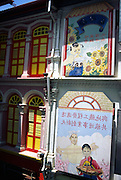 Traditional Chinese picture signs outside restaurant in Chinatown, Singapore