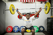 "BEAUFORT, SC - JULY 14: CJ Cummings practices his snatch, clean and jerk at Cross Fit Beaufort while training with weightlifting coach Ray Jones on July 14, 2014 in Beaufort, South Carolina. A former U.S. Olympic coach has called Cummings ""the best weightlifter this country has ever seen."" (Photo by Stephen B. Morton for The Washington Post)"