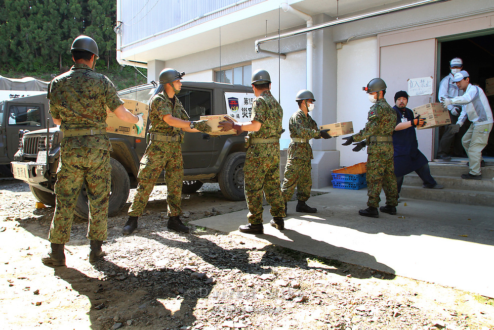 May 18, 2011; Minamisanriku, Miyagi Pref., Japan - 2:31 p.m. Soldiers from Japan's Self-Defense Forces offload a shipment of kitsuden udon at the Shizukawa High School Evacuation Center in Minamisanriku after the magnitude 9.0 Great East Japan Earthquake and Tsunami that devastated the Tohoku region of Japan on March 11, 2011.