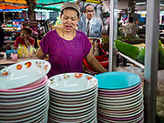 28 MAY 2018 - BANGKOK, THAILAND: A Thai noodle soup vender in Phra Khanong Market in Bangkok. The market serves a mix of Thai working class people and immigrants from Myanmar (Burma).    PHOTO BY JACK KURTZ