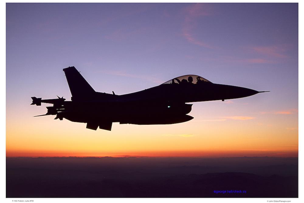 F-16C against sunset sky