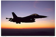 F-16C against sunset sky