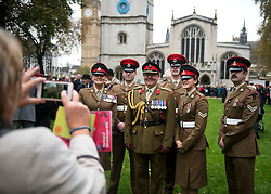 © Licensed to London News Pictures. 04/11/2015. London, UK. A group of service men and women pose for a photograph before a service to mark the opening of the Filed of Remembrance at Westminster Abbey, attended by Prince Philip, Duke of Edinburgh and Prince Harry.  The Field of remembrance is a memorial garden to commemorate British and Commonwealth military and civilian servicemen and women in the two World Wars and later conflicts. Photo credit: Ben Cawthra/LNP